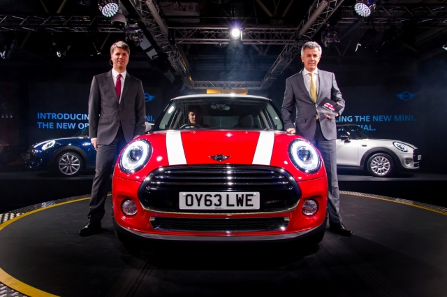 Mr. Harald Krueger, Member of the Board of Management (Production) (L) and Mr. Peter Schwarzenbauer, Member of Board of Management (MINI, BMW Motorrad, Rolls-Royce, Aftersale) (R) with the new MINI